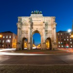 """This Victory Gate in Munich was originally dedicatd to the Bavarian army. It was nearly destroyed in WWII and after reconstroction was dedicated to peace with a plaque reading """"Dedicated to victory, destroyed by war, urging peace"""""""